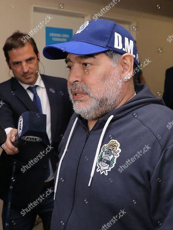 Gimnasia y Esgrima de La Plata's head coach Diego Maradona attends the Mario Alberto Kempes stadium before a match between Gimnasia y Esgrima de La Plata and Club Atlético Talleres of the Superliga Argentina tournament in Cordoba, Argentina, 23 September 2019.