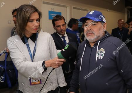 Gimnasia y Esgrima de La Plata's head coach Diego Maradona (R) attends the Mario Alberto Kempes stadium before a match between Gimnasia y Esgrima de La Plata and Club Atlético Talleres of the Superliga Argentina tournament in Cordoba, Argentina, 23 September 2019.