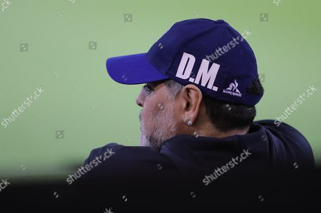 Gimnasia y Esgrima de La Plata's head coach Diego Maradona watches a match between Gimnasia y Esgrima de La Plata and Club Atletico Talleres during the Superliga Argentina tournament at Mario Alberto Kempes stadium in Cordoba, Argentina, 23 September 2019.