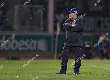 Gimnasia y Esgrima de La Plata's head coach Diego Maradona watches the Superliga Argentina match against Club Atletico Talleres at the Mario Alberto Kempes Stadium in Cordoba, Argentina, 23 September 2019.