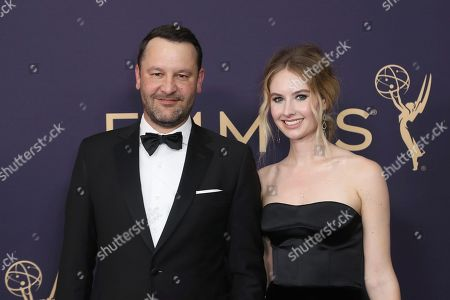 Stock Photo of Dan Fogelman, Caitlin Thompson. Dan Fogelman, left, and Caitlin Thompson arrive at the 71st Primetime Emmy Awards, at the Microsoft Theater in Los Angeles