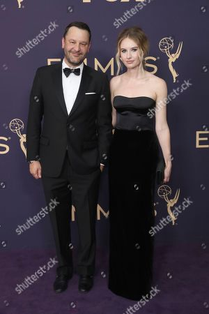 Dan Fogelman, Caitlin Thompson. Dan Fogelman, left, and Caitlin Thompson arrive at the 71st Primetime Emmy Awards, at the Microsoft Theater in Los Angeles