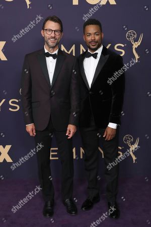 Jonathan King, left, arrives at the 71st Primetime Emmy Awards, at the Microsoft Theater in Los Angeles