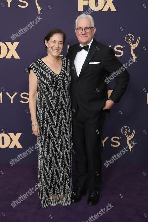 David Linde, right, arrives at the 71st Primetime Emmy Awards, at the Microsoft Theater in Los Angeles