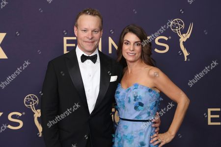 Chris Licht, left, arrives at the 71st Primetime Emmy Awards, at the Microsoft Theater in Los Angeles