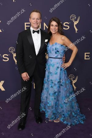 Stock Image of Chris Licht, left, arrives at the 71st Primetime Emmy Awards, at the Microsoft Theater in Los Angeles
