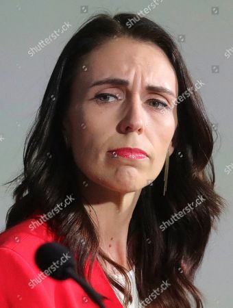 New Zealand Prime Minister Jacinda Ardern listens during a news conference with Facebook COO Sheryl Sandberg, outlining an anti-terror initiative between governments and technology companies called GIFCT--Global Internet Forum to Combat Terrorism, in New York