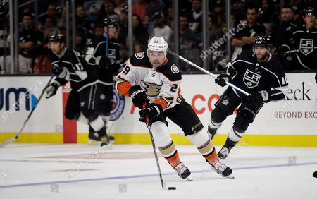 Devin Shore, Michael Amadio. Anaheim Ducks' Devin Shore, center, skates past Los Angeles Kings' Michael Amadio, right, during the first period of a preseason NHL hockey game, in Los Angeles