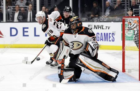 Anaheim Ducks goaltender Ryan Miller stops a shot against the Los Angeles Kings during the second period of a preseason NHL hockey game, in Los Angeles