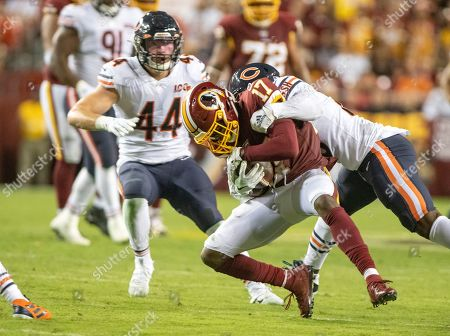 Washington Redskins wide receiver Terry McLaurin (17) is tackled by Chicago Bears cornerback Prince Amukamara (20) in the fourth quarter of the game. Also defending on the play is Chicago Bears inside linebacker Nick Kwiatkoski (44).