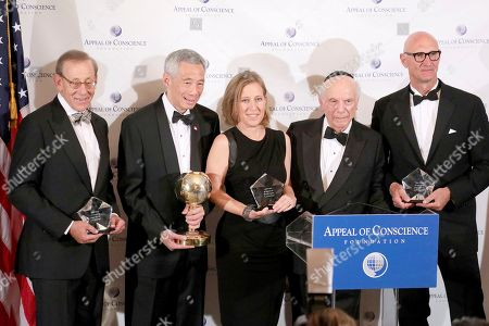 Rabbi Arthur Schneier, Lee Hsien Loong, Stephen Ross, Susan Wojcicki. Rabbi Arthur Schneier, president and founder of the Appeal of Conscience Foundation, second right, presents the 2019 World Statesman Award to Lee Hsien Loong, Prime Minister of Singapore, second left, at the Pierre Hotel in New York. The 2019 Appeal of Conscience Awards were presented to, from left, Stephen Ross, Chairman and Founder of Related Companies; Susan Wojcicki, Chief Executive Officer of YouTube; and Timotheus Höttges, Chief Executive Officer of Deutsche Telekom AG. The World Statesman Award honors leaders who support peaceful coexistence and mutual acceptance in multi-ethnic societies. The Appeal of Conscience Award is presented to visionary business executives with a sense of social responsibility who use their resources and vast reach across boundaries to better serve the global community