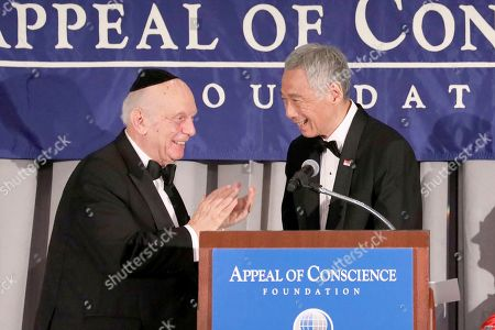 Rabbi Arthur Schneier, president and founder of the Appeal of Conscience Foundation, left, presents the 2019 World Statesman Award to His Excellency Lee Hsien Loong, Prime Minister of Singapore, at the 54th Annual Appeal of Conscience Awards Dinner held at the Pierre Hotel, in New York. The World Statesman Award honors leaders who support peaceful coexistence and mutual acceptance in multi-ethnic societies