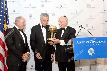 Rabbi Arthur Schneier, president and founder of the Appeal of Conscience Foundation, right, presents the 2019 World Statesman Award to His Excellency Lee Hsien Loong, Prime Minister of Singapore, center, at the 54th Annual Appeal of Conscience Awards Dinner held at the Pierre Hotel, in New York. They are joined by Stephen A. Schwarzman, CEO and Co-Founder of Blackstone, who served as co-chair of the Appeal of Conscience Foundation's annual dinner The World Statesman Award honors leaders who support peaceful coexistence and mutual acceptance in multi-ethnic societies