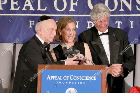 Rabbi Arthur Schneier, Susan Wojcicki, Maurice Lévy. Rabbi Arthur Schneier, left, president and founder of the Appeal of Conscience Foundation, presents the 2019 Appeal of Conscience Award to Susan Wojcicki, Chief Executive Officer of YouTube, center, at the 54th Annual Appeal of Conscience Awards Dinner held at the Pierre Hotel, in New York. They are joined by Maurice Lévy, Chairman of the Supervisory Board of Publicis Groupe. The Appeal of Conscience Award is presented to visionary business executives with a sense of social responsibility who use their resources and vast reach across boundaries to better serve the global community