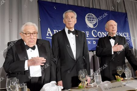 Rabbi Arthur Schneier, president and founder of the Appeal of Conscience Foundation, right, presents the 2019 World Statesman Award to His Excellency Lee Hsien Loong, Prime Minister of Singapore, center, at the 54th Annual Appeal of Conscience Awards Dinner held at the Pierre Hotel, in New York. They are joined by former U.S. Secretary of State Henry Kissinger. The World Statesman Award honors leaders who support peaceful coexistence and mutual acceptance in multi-ethnic societies