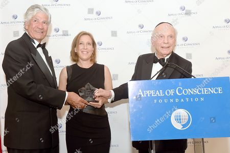 Rabbi Arthur Schneier, president and founder of the Appeal of Conscience Foundation, right, presents the 2019 Appeal of Conscience Award to Susan Wojcicki, Chief Executive Officer of YouTube, center, at the 54th Annual Appeal of Conscience Awards Dinner held at the Pierre Hotel, in New York. They are joined by Maurice Lévy, Chairman of the Supervisory Board of Publicis Groupe. The Appeal of Conscience Award is presented to visionary business executives with a sense of social responsibility who use their resources and vast reach across boundaries to better serve the global community