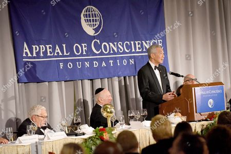 Rabbi Arthur Schneier, president and founder of the Appeal of Conscience Foundation, center, presents the 2019 World Statesman Award to His Excellency Lee Hsien Loong, Prime Minister of Singapore right, at the 54th Annual Appeal of Conscience Awards Dinner held at the Pierre Hotel, in New York. They are joined by former U.S. Secretary of State Henry Kissinger. The World Statesman Award honors leaders who support peaceful coexistence and mutual acceptance in multi-ethnic societies