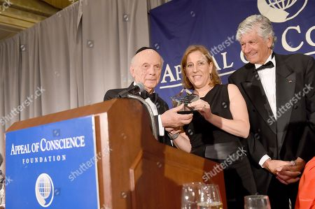 Rabbi Arthur Schneier, president and founder of the Appeal of Conscience Foundation, left, presents the 2019 Appeal of Conscience Award to Susan Wojcicki, Chief Executive Officer of YouTube, center, at the 54th Annual Appeal of Conscience Awards Dinner held at the Pierre Hotel in New York on . They are joined by Maurice Lévy, Chairman of the Supervisory Board of Publicis Groupe. The Appeal of Conscience Award is presented to visionary business executives with a sense of social responsibility who use their resources and vast reach across boundaries to better serve the global community