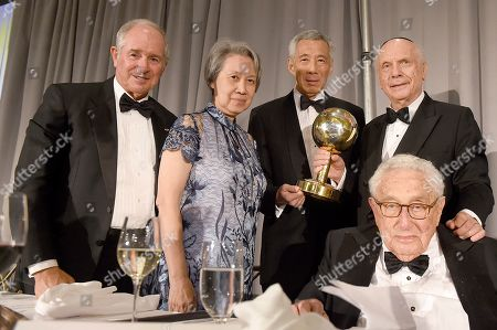 Stock Image of Rabbi Arthur Schneier, president and founder of the Appeal of Conscience Foundation, top right, presents the 2019 World Statesman Award to His Excellency Lee Hsien Loong, Prime Minister of Singapore, center, at the 54th Annual Appeal of Conscience Awards Dinner held at the Pierre Hotel, in New York. They are joined by, from left, Stephen A. Schwarzman, CEO and Co-Founder of Blackstone and co-chair of the Appeal of Conscience Foundation's annual dinner; Ho Ching, Chief Executive Officer of Temasek Holdings, second from left, and former U.S. Secretary of State Henry Kissinger. The World Statesman Award honors leaders who support peaceful coexistence and mutual acceptance in multi-ethnic societies