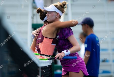 Monica Puig of Puerto Rico & Alison Riske of the United States at the net after their second-round match