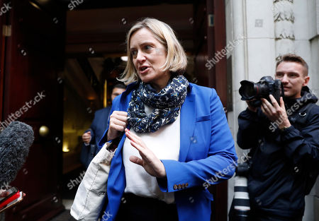 British Conservative Party lawmaker Amber Rudd speaks to the media in London, . In a decision with wide-ranging political ramifications, Britain's Supreme Court plans to give its verdict Tuesday on the legality of Prime Minister Boris Johnson's five-week suspension of Parliament