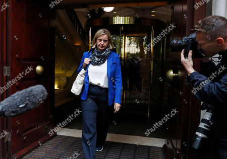 British Conservative Party lawmaker Amber Rudd approaches waiting media in London, . In a decision with wide-ranging political ramifications, Britain's Supreme Court plans to give its verdict Tuesday on the legality of Prime Minister Boris Johnson's five-week suspension of Parliament