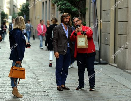 Stock Picture of Andrea Pirlo takes a selfie with a fan while Valentina Baldini looks on