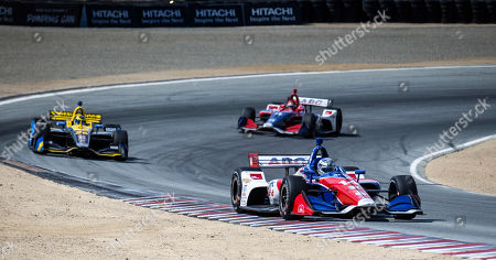 Stock Picture of Monterey, CA, U.S.A. A.J. Foyt Enterprises driver Tony Kanaan (14) leads the pack coming out of turn 5 during the Firestone Grand Prix of Monterey IndyCar Championship at Weathertech Raceway Laguna Seca Monterey, CA Thurman James / CSM