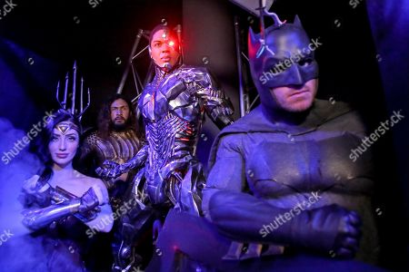 Cosplayers Danijela Dacic as Wonder Woman, Lester Jamieson as Aquaman and Chris Stanley as Batman poses for a photograph with the newly unveiled 'Cyborg' stature in the Justice League exhibit during an Oz Comic-Con media preview at Madame Tussauds wax museum in Sydney, New South Wales, Australia, 24 September 2019. The Oz Comic-Con takes place in Sydney on 28 and 29 September.