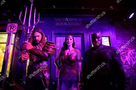 Stock Photo of Cosplayers Lester Jamieson as Aquaman, Danijela Dacic as Wonder Woman and Chris Stanley as Batman pose for a photograph during an Oz Comic-Con media preview at Madame Tussauds wax museum in Sydney, New South Wales, Australia, 24 September 2019. The Oz Comic-Con takes place in Sydney on 28 and 29 September.
