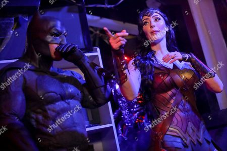 Cosplayers Chris Stanley as Batman and Danijela Dacic as Wonder Woman during an Oz Comic-Con media preview at Madame Tussauds wax museum in Sydney, New South Wales, Australia, 24 September 2019. The Oz Comic-Con takes place in Sydney on 28 and 29 September.