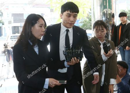 South Korean superstar Seungri (C), who is a former member of group Big Bang, arrives for second summons at the Seoul Metropolitan Police Agency in Seoul, South Korea, 24 September 2019. Seungri and Yang Hyun-suk, former chief producer and founder of YG Entertainment, will be investigated by police on charges of illegal gambling abroad. They are suspected of gambling up to tens of millions of won at a time at casinos, including the MGM Hotel and Casino in Las Vegas. Gambling is illegal in Korea.