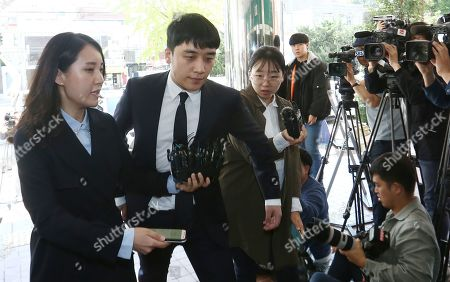 Stock Image of South Korean superstar Seungri (2L), who is a former member of group Big Bang, arrives for second summons at the Seoul Metropolitan Police Agency in Seoul, South Korea, 24 September 2019. Seungri and Yang Hyun-suk, former chief producer and founder of YG Entertainment, will be investigated by police on charges of illegal gambling abroad. They are suspected of gambling up to tens of millions of won at a time at casinos, including the MGM Hotel and Casino in Las Vegas. Gambling is illegal in Korea.