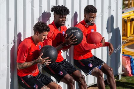 Atletico Madrid's Uruguayan defender Jose Maria Gimenez (L), Ghanaian midfielder Thomas Partey (C) and French winger Thomas Lemar during the team's training session at Wanda Sport City, in Majadahonda, outside Madrid, Spain, 24 September 2019. The team prepare for their upcoming La Liga match against RCD Mallorca on 25 September.