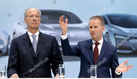 Herbert Diess, right, CEO of German car maker Volkswagen, and Hans Dieter Poetsch, left, chairman of the board of directors of Volkswagen address the media during a press conference in Wolfsburg, Germany. German prosecutors say they have charged Volkswagen chief executive Herbert Diess and chairman Hans Dieter Poetsch, along with former CEO Martin Winterkorn, with market manipulation in connection with the diesel emissions scandal that erupted in 2015