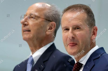 Herbert Diess, right, CEO of the Volkswagen, and Hans Dieter Poetsch, left, chairman of the board of directors of Volkswagen address the media during a press conference in Wolfsburg, Germany. German prosecutors say they have charged Volkswagen chief executive Herbert Diess and chairman Hans Dieter Poetsch, along with former CEO Martin Winterkorn, with market manipulation in connection with the diesel emissions scandal that erupted in 2015