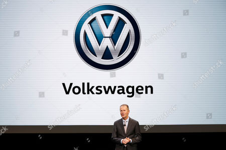 Herbert Diess, CEO, Volkswagen AG, speaks during media previews for the North American International Auto Show in Detroit. German prosecutors say they have charged Volkswagen chief executive Herbert Diess and chairman Hans Dieter Poetsch, along with former CEO Martin Winterkorn, with market manipulation in connection with the diesel emissions scandal that erupted in 2015