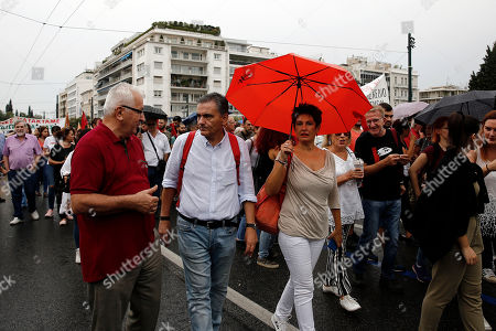 Greek former Finance Minister Euclid Tsakalotos (2-L) take part wit labor unionists and students in a protest during a 24-hour general strike in Athens, Greece, 24 September 2019. The unions are joining in 24-hour strike action announced by the civil servants union federation ADEDY and the Athens-Piraeus Labor Centers against the provisions of the bill on labor issues.