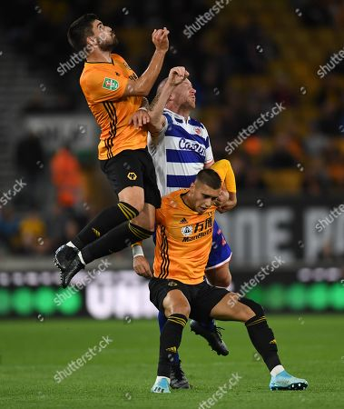 Stock Image of Charlie Adam of Reading competes with Ruben Neves nd Bruno Jordao of Wolverhampton Wanderers