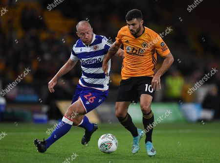 Stock Photo of Charlie Adam of Reading and Patrick Cutrone of Wolverhampton Wanderers
