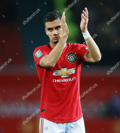 Andreas Pereira of Manchester United thanks the fans at the end of the game