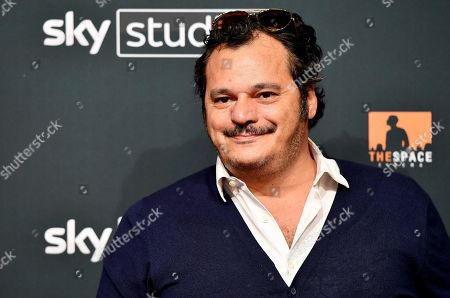 Stock Photo of Antonio Gerardi poses for the media during the photo call for the Sky TV series '1994' in Rome, Italy, 24 September 2019.
