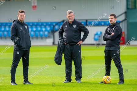 Stock Photo of (LtoR) Heart of Midlothian coach Jon Daly, Heart of Midlothian manager Craig Levein and coack Liam Fox watch the team train at The Oriam Sports Performance Centre, Heriot Watt University, Edinburgh, ahead of the Betfred Scottish Football League Cup quarter-final match against Aberdeen. Picture by Malcolm Mackenzie