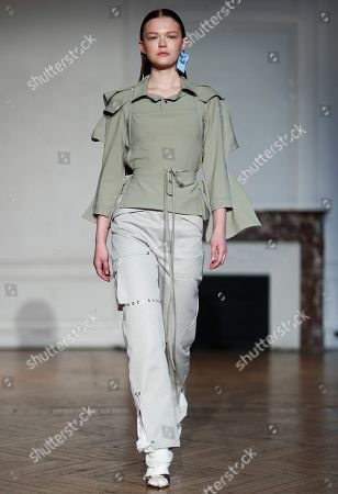 Stock Photo of Models present creations from the Women Spring/Summer 2020 collection by French designer Pierre Kaczmarek and Italian designer Elena Mottola for Afterhomework during the Paris Fashion Week, in Paris, France, 24 September 2019. The presentation of the Women's collections runs from 23 September to 01 October.