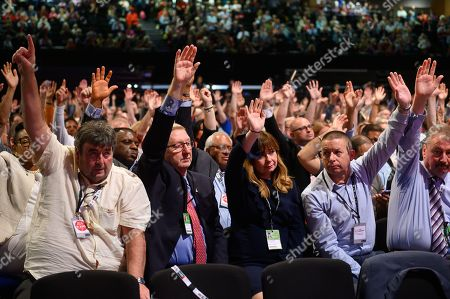 L-R (Unkown), Len McCluskey, Anneliese Midgley, Howard Beckett from Unite the Union, voting on Labour's stance on Brexit