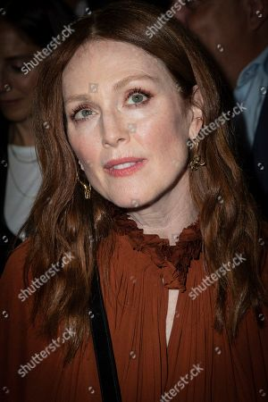 Julianne Moore poses for photographers ahead of the Dior Ready To wear Spring-Summer 2020 collection, unveiled during the fashion week, in Paris