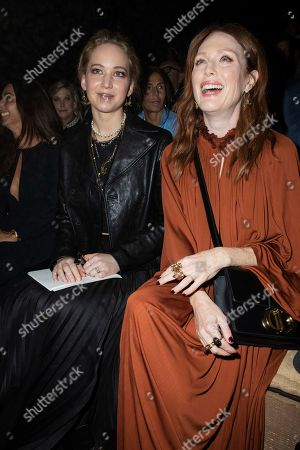 Jennifer Lawrence, Julianne Moore. Jennifer Lawrence and Julianne Moore pose for photographers ahead of the Dior Ready To wear Spring-Summer 2020 collection, unveiled during the fashion week, in Paris