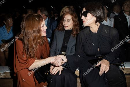 Julianne Moore, Isabelle Huppert, Moica Bellucci. Julianne Moore, Isabelle Huppert and Monica Bellucci pose for photographers ahead of the Dior Ready To wear Spring-Summer 2020 collection, unveiled during the fashion week, in Paris