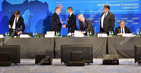 UEFA president Aleksander Ceferin (C), UEFA competitions director Giorgio Marchetti (3R), Karl-Erik Nilsson (C left), Swedish Football Association (SvFF) president and UEFA first vice-president and UEFA secretary general Theodore Theodoridis (2R), at the start of the UEFA Executive Committee meeting in Ljubljana, Slovenia, 24 September 2019.