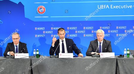 The President of the UEFA Aleksander Ceferin (C) gestures to the media at a press conference accompanied by Giorgio Marchetti (L) and Phil Townsend (R) during the UEFA  Executive Committee members meeting in Ljubljana, Slovenia, 23 September 2019. The UEFA has announced the venues for the Champions League finals 2021 (St. Petersburg), 2022 (Munich) and 2023 (London/Wembley).